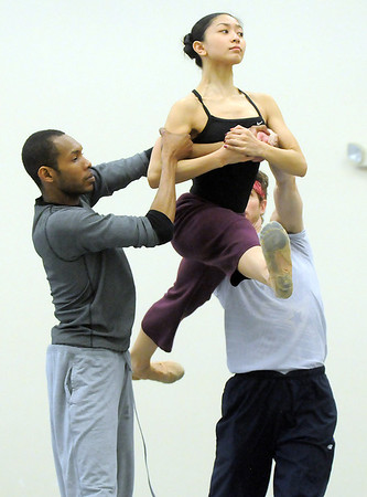 "Marian Faustino is lifted into the air by Damien Patterson, left,  and Colby Foss during rehearsal of Ballet Nouveau Colorado's Love in the Digital Age on Saturday.<br /> For more photos please see  <a href=""http://www.broomfieldenterprise.com"">http://www.broomfieldenterprise.com</a><br /> January 21, 2012<br /> staff photo/ David R. Jennings"