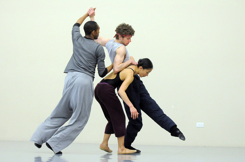 """Damien Patterson, left, Colby Foss and Marian Faustino dance together during rehearsal of Ballet Nouveau Colorado's Love in the Digital Age on Saturday.<br /> For more photos please see  <a href=""""http://www.broomfieldenterprise.com"""">http://www.broomfieldenterprise.com</a><br /> January 21, 2012<br /> staff photo/ David R. Jennings"""