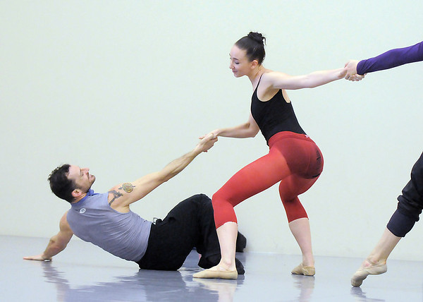 """Brandon Freeman, left, and Meredith Strathmeyer perform a dance together with Ben Delony, right, during rehearsal of Ballet Nouveau Colorado's Love in the Digital Age on Saturday.<br /> For more photos please see  <a href=""""http://www.broomfieldenterprise.com"""">http://www.broomfieldenterprise.com</a><br /> January 21, 2012<br /> staff photo/ David R. Jennings"""