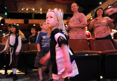 Jacqueline Fairbairn, 4, watches and dances with the company dancers during Ballet Nouveau Colorado's young person's guide to dance at the Auditorium on Satuday. March 24, 2012  staff photo/ David R. Jennings
