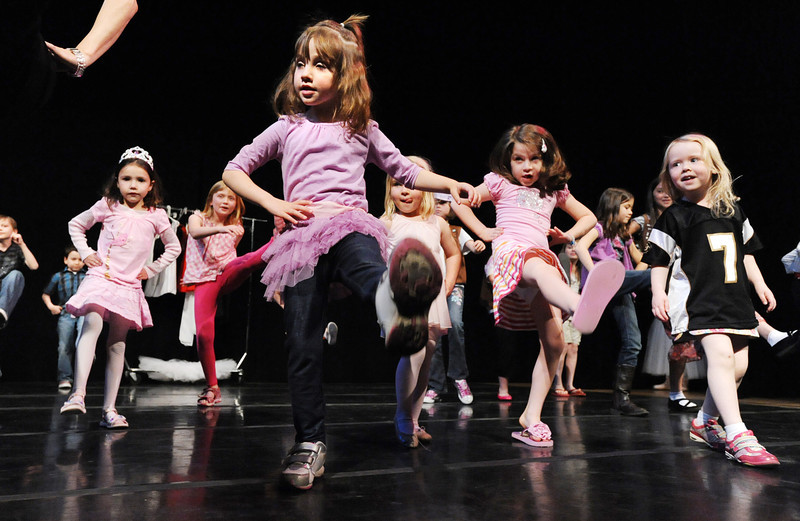Alexis Powell, 7, left, Ellie Stillman, 3, Grace Leone, 5, and Jacqueline Fairbairn, 4, dance on stage with Dawn Fay, associate artistic director, during Ballet Nouveau Colorado's young person's guide to dance at the Auditorium on Satuday.<br /> March 24, 2012 <br /> staff photo/ David R. Jennings