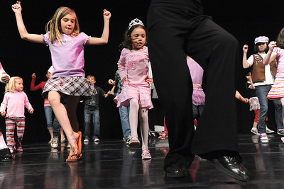 Emma Knight, 8, left, and Alexis Powel, 7, follow the steps of Dawn Fay, associate artistic director, on stage during Ballet Nouveau Colorado's young person's guide to dance at the Auditorium on Satuday. March 24, 2012  staff photo/ David R. Jennings
