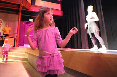 Ellie Stillman, 3, watches and dances with the BNC company dancers perfom during Ballet Nouveau Colorado's young person's guide to dance at the Auditorium on Satuday. March 24, 2012  staff photo/ David R. Jennings