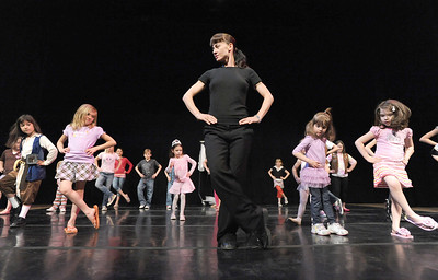 Dawn Fay, center, associate artisic director, leads children in a dance on stage during Ballet Nouveau Colorado's young person's guide to dance at the Auditorium on Satuday. March 24, 2012  staff photo/ David R. Jennings