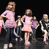 Ellie Stillman, 3, left, Grace Leone, 5, and Jacqueline Fairbairn, 4, dance on stage with Dawn Fay, associate artistic director, during Ballet Nouveau Colorado's young person's guide to dance at the Auditorium on Satuday.<br /> March 24, 2012 <br /> staff photo/ David R. Jennings