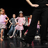 Emma Knight, 8, left, and Alexis Powel, 7, follow the steps of Dawn Fay, associate artistic director, on stage during Ballet Nouveau Colorado's young person's guide to dance at the Auditorium on Satuday.<br /> March 24, 2012 <br /> staff photo/ David R. Jennings