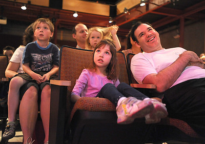 Ellie Stillman, 3, center, and her father David with Colton Fairbairns, 5, left, and his sister, Jacqueline, watch company dancers perfom during Ballet Nouveau Colorado's young person's guide to dance at the Auditorium on Satuday. March 24, 2012  staff photo/ David R. Jennings