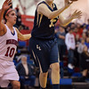 Legacy's Courtney Smith passes the ball away from Centaurus' Gianna Manfredini during Saturday's Boulder Valley Invitational tournament at Centaurus..<br /> <br /> December 8, 2012<br /> staff photo/ David R. Jennings