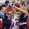 Centaurus' Anna Hubbell fights for the ball with Legacy's Courtney Smith and Bree Paulson during Saturday's Boulder Valley Invitational tournament at Centaurus..<br /> <br /> December 8, 2012<br /> staff photo/ David R. Jennings