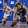 Centaurus's Anna Hebbell and Legacy's Jenna Fenton go after a loose ball during Saturday's Boulder Valley Invitational tournament at Centaurus..<br /> <br /> December 8, 2012<br /> staff photo/ David R. Jennings