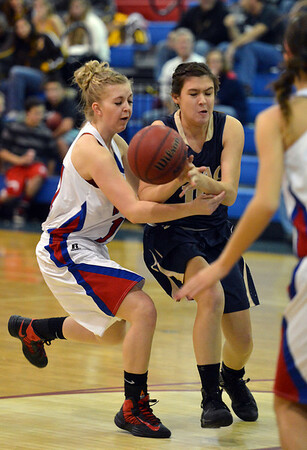 Audrey Harriger, Centaurus, knocks the ball from Jenna Fenton, Legacy, during Saturday's Boulder Valley Invitational tournament at Centaurus..<br /> <br /> December 8, 2012<br /> staff photo/ David R. Jennings