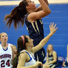 Legacy's Shayna Kuyper goes to the basket past Centaurus' Anna Hubbell during Saturday's Boulder Valley Invitational tournament at Centaurus..<br /> <br /> December 8, 2012<br /> staff photo/ David R. Jennings