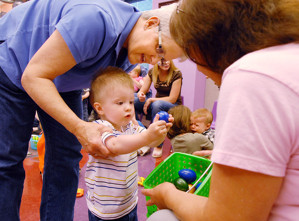 Henry Kennedy, 18 months-old, with his grandmother, Dee Passard, gives librarian Kathy Klatt a rattle after Thursday's Baby Story Time at the Children's Library at Mamie Doud Eisenhower Public Library.<br /> June 9, 2011<br /> staff photo/David R. Jennings