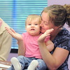 "Joslyn Elges, 9 months-old, plays ""Pat-a-Cake"" with her mother, Carole, during a song at Thursday's Baby Story Time at the Children's Library at Mamie Doud Eisenhower Public Library.<br /> June 9, 2011<br /> staff photo/David R. Jennings"