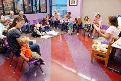 Children with their relatives listen to librarian Kathy Klatt read a story during the first session of Thursday's Baby Story Time at the Children's Library at Mamie Doud Eisenhower Public Library. June 9, 2011 staff photo/David R. Jennings