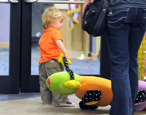 Gabriel D'Ascanio, 20 months-od, carries a stuffed toy to the door of the library after attending Thursday's Baby Story Time at the Children's Library at Mamie Doud Eisenhower Public Library.<br /> June 9, 2011<br /> staff photo/David R. Jennings