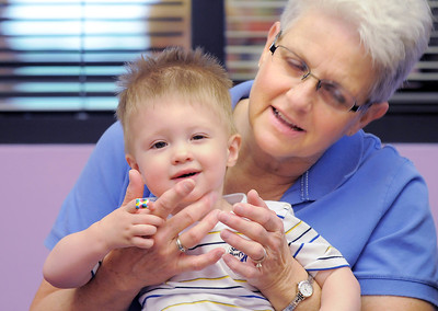 """Henry Kennedy, 18 months-old, plays """"Pat-a-cake"""" with his grandmother Dee Passard during Thursday's Baby Story Time at the Children's Library at Mamie Doud Eisenhower Public Library. June 9, 2011 staff photo/David R. Jennings"""