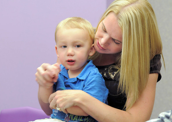 Jett Sloan, 17 months-old, moves to a song with his mother, Malissa during Thursday's Baby Story Time at the Children's Library at Mamie Doud Eisenhower Public Library.<br /> June 9, 2011<br /> staff photo/David R. Jennings