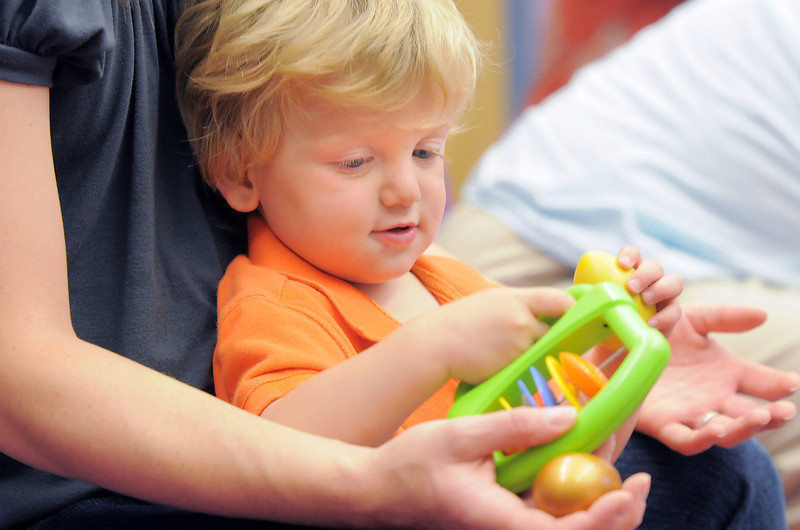 Gabriel D'Ascanio, 20 months-old, shakes a noise maker with his mother, Julie, during Thursday's Baby Story Time at the Children's Library at Mamie Doud Eisenhower Public Library.<br /> June 9, 2011<br /> staff photo/David R. Jennings