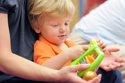 Gabriel D'Ascanio, 20 months-old, shakes a noise maker with his mother, Julie, during Thursday's Baby Story Time at the Children's Library at Mamie Doud Eisenhower Public Library. June 9, 2011 staff photo/David R. Jennings