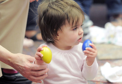 Kathleen Burke, 14 months-old, shakes rattles to the music during Thursday's Baby Story Time at the Children's Library at Mamie Doud Eisenhower Public Library. June 9, 2011 staff photo/David R. Jennings