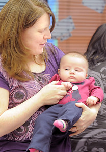 Kristin Miesel holds her daughter Elena, 3 1/2 months-old, while listening to songs during Thursday's Baby Story Time at the Children's Library at Mamie Doud Eisenhower Public Library. June 9, 2011 staff photo/David R. Jennings