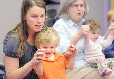 Julie D'Ascanio and her son Gabriel, 20 months-old, sing and move along to a song with Kathleen Burke, 14 monhts-old, and her grandmother, Claire Meushaw, right, during Thursday's Baby Story Time at the Children's Library at Mamie Doud Eisenhower Public Library. June 9, 2011 staff photo/David R. Jennings