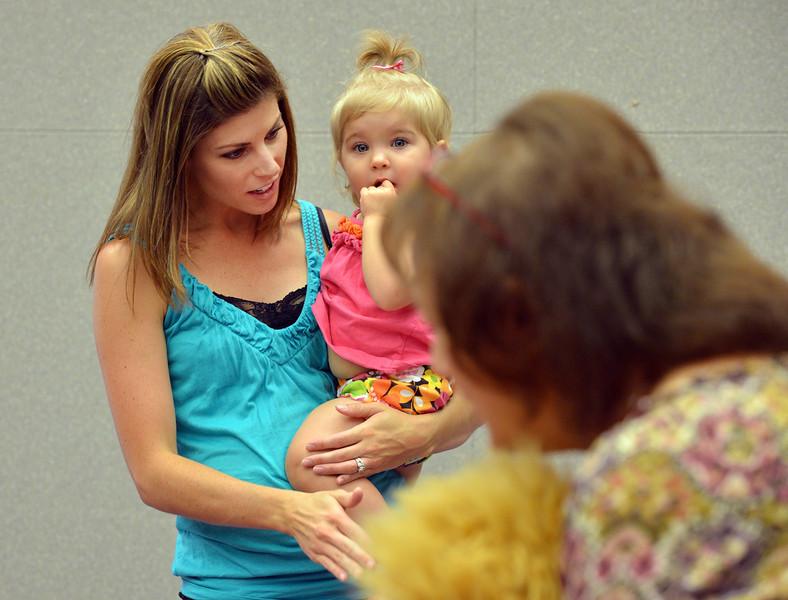 be0719babystory02.JPG Kari Kohlslistens to a story with her daughter Kinley, 15 months-old, during Baby Story Time at the children's library on Thursday.<br /> <br /> July 14, 2012<br /> staff photo/ David R. Jennings