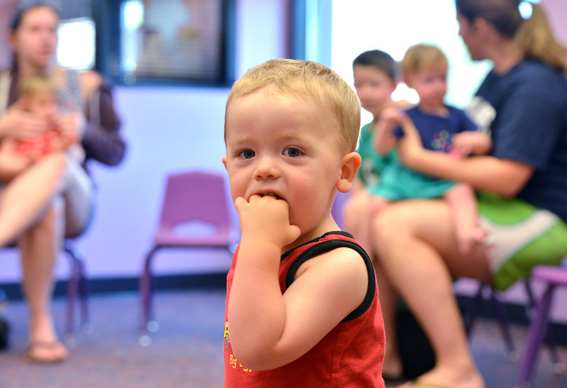 be0719babystory10.JPG Wyatt Smith, 20 months -old, wanders while a story is being read during Baby Story Time at the children's library on Thursday.<br /> <br /> July 12, 2012<br /> staff photo/ David R. Jennings
