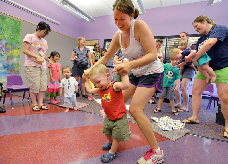 be0719babystory01.JPG Jamie Smith dances with her son Wyatt, 1 1/2, during Baby Story Time at the children's library on Thursday.<br /> <br /> July 12, 2012<br /> staff photo/ David R. Jennings