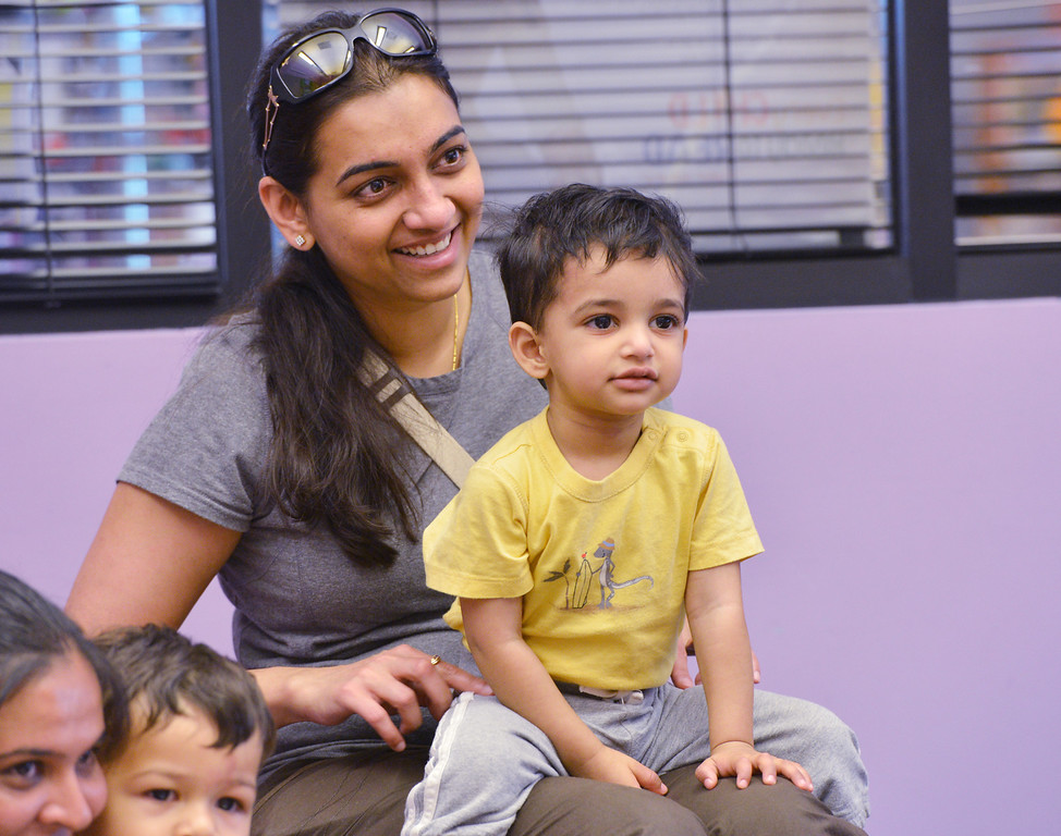be0719babystory14.JPG Pryanka Goel with her son Aarav, 18 months-old, listen to a story during Baby Story Time at the children's library on Thursday.<br /> <br /> <br /> July 12, 2012<br /> staff photo/ David R. Jennings