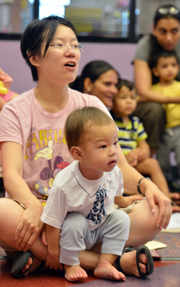 be0719babystory05.JPG Shuang Wang with her son Justin 20 months old, listen to a story  during Baby Story Time at the children's library on Thursday.<br /> <br /> July 12, 2012<br /> staff photo/ David R. Jennings