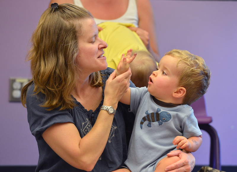 be0719babystory04.JPG Kathy Knight sings with her son Owen, 14 months old,  during Baby Story Time at the children's library on Thursday.<br /> <br /> July 12, 2012<br /> staff photo/ David R. Jennings