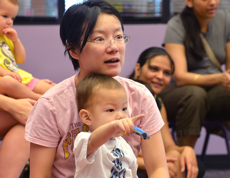 be0719babystory11.JPG Shuang Wang, left, and her son Justin, 20 months-old, listen to a story  during Baby Story Time at the children's library on Thursday.<br /> <br /> July 12, 2012<br /> staff photo/ David R. Jennings