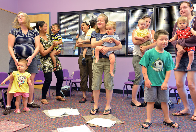 be0719babystory08.JPG Baby Story Time attendees dance with their children to a song at the children's library on Thursday.<br /> <br /> July 12, 2012<br /> staff photo/ David R. Jennings