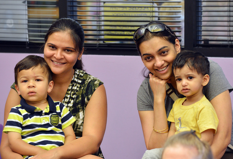 be0719babystory12.JPG Pankti Mehta and her son Arnav, 14 months-old, left, listens to a story with Pryanka Goel with her son Aarav, 18 months-old, during Baby Story Time at the children's library on Thursday.<br /> <br /> <br /> July 12, 2012<br /> staff photo/ David R. Jennings