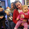 Jen Seifried and daughter Kylie, 1, right, dance along with Toni Maggio and daughter Emma 9 weeks, with Kristin Johnsen and son Luc, 11 months-old, during  Baby Story Time at Mamie Doud Eisenhower Public Library Children's Library on Thursday.  <br /> <br /> April 8, 2010<br /> Staff photo/David R. Jennings
