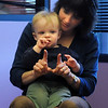 Kristin Johnsen motions with her son Luc, 11 months-old, during  Baby Story Time at Mamie Doud Eisenhower Public Library Children's Library on Thursday.  <br /> <br /> April 8, 2010<br /> Staff photo/David R. Jennings