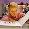 Callie Ward, 18 months-old, starts to look at a  book after  Baby Story Time at  Mamie Doud Eisenhower Public Library Children's Library on Thursday.  <br /> <br /> April 8, 2010<br /> Staff photo/David R. Jennings