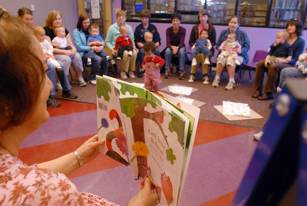 Librarian Kathy Klatt reads a book during  Baby Story Time at Mamie Doud Eisenhower Public Library Children's Library on Thursday.  Klatt said it's important for parents to read to and with their children every day.<br /> <br /> April 8, 2010<br /> Staff photo/David R. Jennings