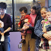Gemma Amaria, 15 months-old, with her mother Gina, left, Ethan Amaria, 15 months-old, with his aunt Kelly Kehmeier, and Nora Scharff, 4 months-old, with her mother Margaret dance together during  Baby Story Time at the  Mamie Doud Eisenhower Public Library Children's Library on Thursday. <br /> <br /> April 8, 2010<br /> Staff photo/David R. Jennings