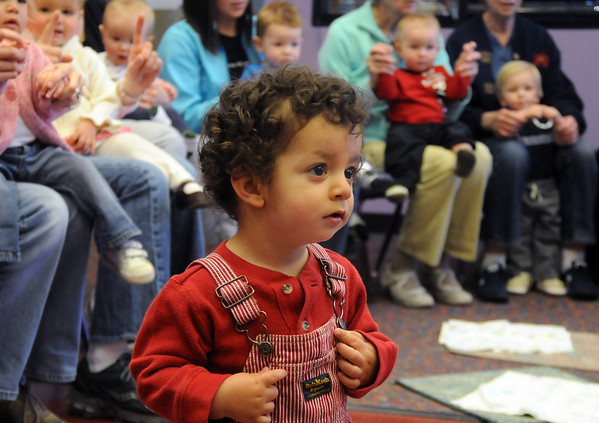 Ethan Amaria, 15 months-old, wanders while listening to librarian Kathy Klatt read a story during  Baby Story Time at Mamie Doud Eisenhower Public Library Children's Library on Thursday.  <br /> <br /> April 8, 2010<br /> Staff photo/David R. Jennings