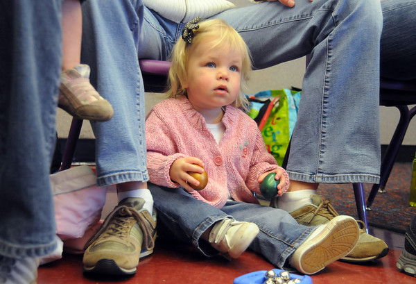 Callie Ward, 18 months-old, shakes egg shaped rattles while sitting on the floor during  Baby Story Time at Mamie Doud Eisenhower Public Library Children's Library on Thursday.  <br /> <br /> April 8, 2010<br /> Staff photo/David R. Jennings