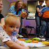 Charlie Murray, 6 months-old, plays on the floor during  Baby Story Time at the Children's Library of Mamie Doud Eisenhower Public Library on Thursday.  <br /> <br /> April 8, 2010<br /> Staff photo/David R. Jennings