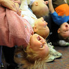 Callie Ward, 18 months-old, left, Lucy Hansen, 18 months-old, Charlie Murray, 6 months-old, and Aiden Archibald, 1 1/2,  are held upside down by their mothers during Baby Story Time at  Mamie Doud Eisenhower Public Library Children's Library on Thursday.  <br /> April 8, 2010<br /> Staff photo/David R. Jennings