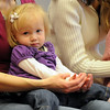 Clara Benzley, 19 months-old, sits in the lap of her mother, Caroline while listening to a story during Baby Story Time at  Mamie Doud Eisenhower Public Library Children's Library on Thursday.  The library is celebrating National Library Week. This is the 6th year of Baby Story Time while has expanded to 2 sessions on Thursday's.<br /> <br /> April 8, 2010<br /> Staff photo/David R. Jennings