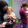 Ariana Hall dances with her daughter Danika, 17 months-old, during  Baby Story Time at Mamie Doud Eisenhower Public Library Children's Library  on Thursday. <br /> <br /> April 8, 2010<br /> Staff photo/David R. Jennings