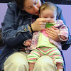 Margaret Scharff touches the nose of her daughter, Nora, 4 months-old, during  Baby Story Time at Mamie Doud Eisenhower Public Library Children's Library on Thursday.  <br /> <br /> April 8, 2010<br /> Staff photo/David R. Jennings