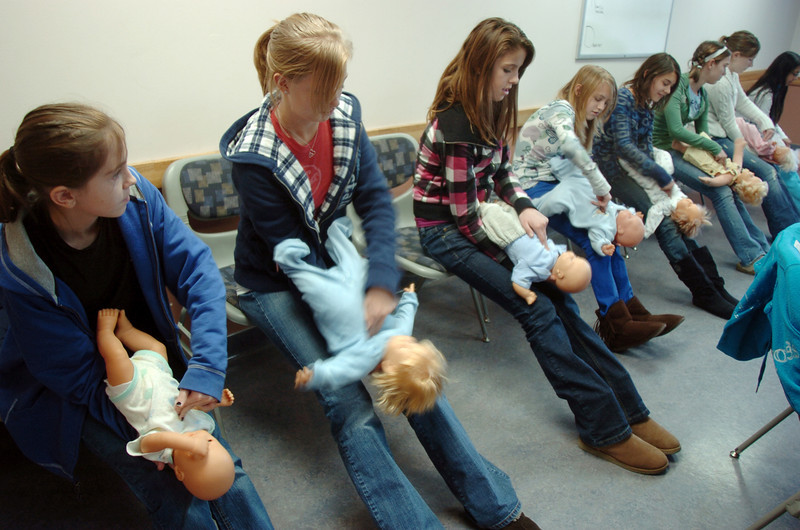The babysitting class practices how to clear a baby's blocked airway on dolls during the American Red Cross babysitter class at the Broomfield Community Center on Saturday.<br /> <br /> January 09, 2010<br /> Staff photo/David R. Jennings