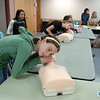 Emily DiGregorio, 11, listens for a breath on a child dummy while learning rescue breathing during the American Red Cross babysitter class at the Broomfield Community Center on Saturday.<br /> <br /> January 09, 2010<br /> Staff photo/David R. Jennings